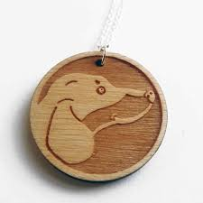 close up of dachshund necklace featuring birch plywood pendant on sterling silver trace chain