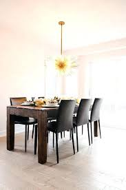 crate and barrel folio chair brass sea urchin chandelier in dining room crate and barrel folio crate and barrel