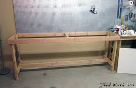 diy wall mounted workbench. wood 2x4s bench and peg board on wall to hold tools diy mounted workbench !