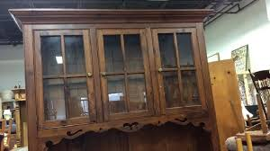 wooden hutch with glass doors