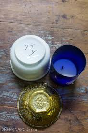 the glass cobalt blue container used to be a candle holder so no great mystery here i just cleaned it out with very hot water and dish soap