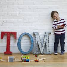image of our large vintage metal letters this one spells out tom with a young