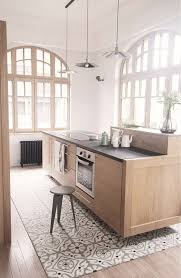mosaic floor tiles under the kitchen island and wooden floors around