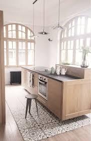 mosaic floor tiles under the kitchen island and wooden floors around