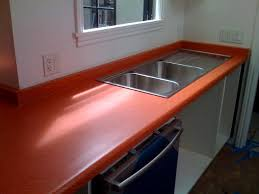 we specialize in doing custom work including under mount solid surface sinks mounted into laminate countertops