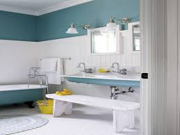 white bathroom with blue painted wall and clawfoot bathtub and towel racks also white laminate wood flooring for kids bathroom design ideas