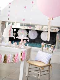 blissful pink gold cake table with tassel garland