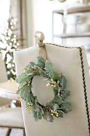 dining room chairs decorated for christmas. hang wreaths on the back of dining room chairs. could put wreaths, or ornaments chairs decorated for christmas o