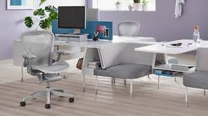 office chairs design. Two Light Gray Aeron Office Chairs In A Public Landscape Setting. Design B