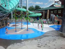 the resulting bear foot island sprayground is a 3364 square foot vortex splashpad that sprays shootists water upwards from geysers and jets in the