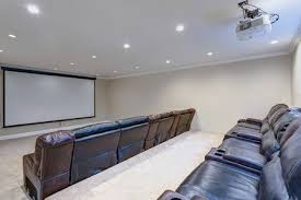 basement movie room. Wonderful Room 91634827  Contemporary Basement Movie Room Features A White Ceiling  Accented With Projector Over Black Leather Chairs To Basement Movie Room