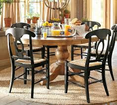 this featured dining room from pottery barn may be the inspiration you need it features a weathered pedestal dining table