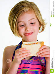 eating a peanut butter and jelly sandwich. Child With Sandwich To Eating Peanut Butter And Jelly