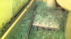 bathroom glass door shattered by itself