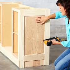 kitchen island from stock cabinets use a spacer to set the height of the end panel