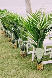 tropical wedding reception ideas pineapple palm frond aisle decor