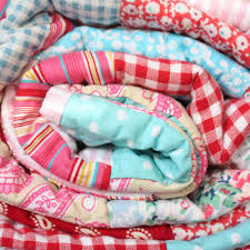 patchwork cot bed quilt