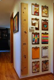playroom office. Thrifted Clipboards Used To Create A Gallery Wall For Kids Artwork, Calendars, Photos, Playroom Office