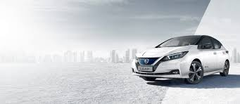 nissan leaf 3 4 front with city in the background