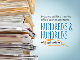 stack of resumes and applications