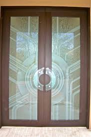 recently installed by sans soucie art glass are these stunning etched glass doors featuring