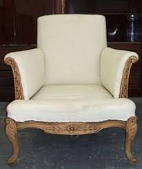 A stripped chair ready to be upholstered.