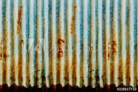background of ling paint and rusty old metal zinc wall texture pattern background rusty corrugated metal old decay photo