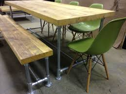 reclaimed industrial scaffold board dining table with matching bench and 4 eames inspired dsw side chairs