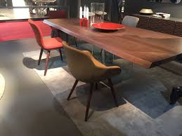solid wood dining top and glass base annie chairs from calligaris