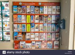 Old Brochures Shelf With Brochures Inside Solitaire Gas Station And Old Phone On