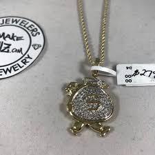 custom pendant made with 10k gold and diamonds