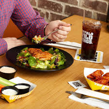 buffalo wild wings home facebook image contain food