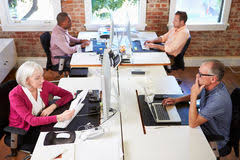 wide angle view busy design office. group of workers at desks in modern design office stock image wide angle view busy e