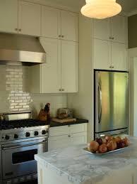 gorgeous creamy white kitchen design with cream shaker kitchen cabinets glossy off white subway tiles backsplash soapstone countertops cream kitchen