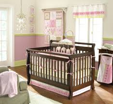 anthropologie crib bedding in pink with brown wooden box on floor for nursery decor style baby