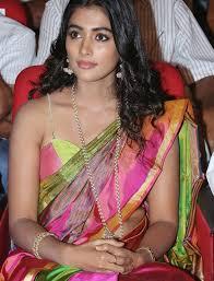 Pooja Hegde Looks Smoking Hot In a Revealing Saree At Manam 100.