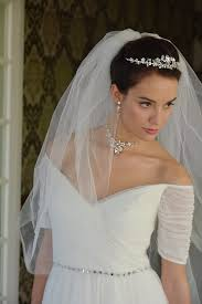 earrings for wedding dress. bride wearing crystal necklace, pierced earrings and tiara set mariell 4005 for wedding dress