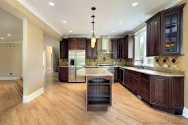 Small Picture Dark cherry cabinets maple hardwood and light countertops