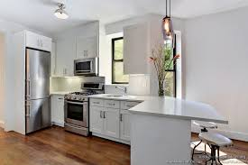 minimalist white kitchen published in blacklines of design