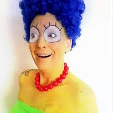Woman smiles through cancer treatments by dressing as iconic ...