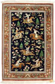 a figural ghom carpet from the city of ghom in iran