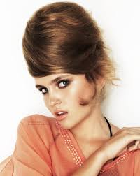 Sixties Hair Style beehive hairdo with the hair wrapped into a vertical swirl on top 8792 by wearticles.com