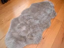 grey faux fur rug shapes dark blanket