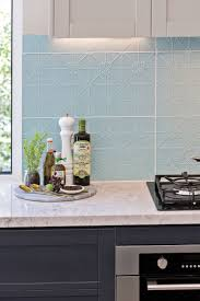 Tiled splashback inspired by the pressed metal roofs of yesteryear.  Interior style: Classic Hamptons
