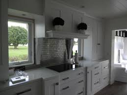 furniture amazing white ultracraft cabinets with brick backsplash amazing white ultracraft cabinets with brick backsplash and floating potted flowers plus glass window for white kitchen design