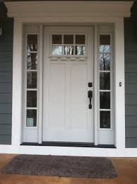 clopay craftsman collection fibergl front door factory painted in white with clarion window knock knock pinte