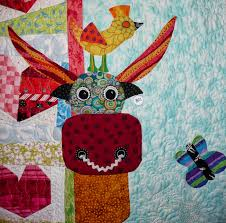 Come Quilt (Sue Garman): Cows and Quilts & I'm sure there's no meaning in that (ha ha). Note the sweet quilting motifs  in the background. These cows are just SO cute! Adamdwight.com
