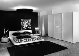 sophisticated romantic black and white bedrooms design with white gloss sliding door wardrobe as well as white low master beds frames on black bedroom areas