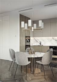 apartment kitchen dark white polished marble backsplash countertop round dining table pedestal stainless steel appliances black wire chair fabric seating l
