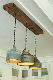 farmhouse lighting fixtures. like how fixtures attached to piece of wood makes me think all the oldu2026 farmhouse lighting o